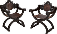 A Pair of Renaissance-Style Carved Walnut Savonarola Chairs 32 h x 25-1/4 w x 22-1/2 d inches (81.3 x 64.1 x 57.2