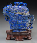 Asian:Chinese, A Chinese Archaistic Lapis Lazuli Covered Pouring Vessel on Stand,Qing Dynasty, 19th century. Marks: Carved six-character Q...