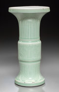 Asian:Chinese, A Chinese Incised Celadon Glazed Porcelain Gu Beaker Vase, QingDynasty, Kangxi Period, circa 1644-1722. 9-1/2 inches high (...