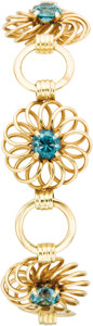 Estate Jewelry:Bracelets, Blue Zircon, Gold Bracelet. The bracelet consists of 14k goldpinwheel links, highlighted by a round-cut blue zircon. Tota...(Total: 1 Item)
