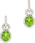 Estate Jewelry:Earrings, Peridot, Diamond, White Gold Earrings. Each huggy-style earringfeatures full-cut diamonds, set in 18k white gold, support...(Total: 1 Item)