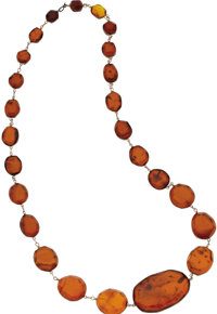 Amber Necklace  The necklace features amber tablets, graduated in size, wire-wrapped in yellow metal. Gross weight 41.50...