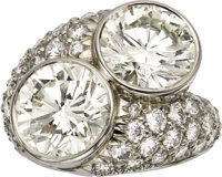 Diamond, Platinum Ring, Leverington  The bypass ring features two round brilliant-cut diamonds, one measuring 10.40 - 10...