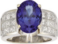 Estate Jewelry:Rings, Tanzanite, Diamond, White Gold Ring. The ring features anoval-shaped tanzanite measuring 13.25 x 9.90 x 8.20 mm and weigh...(Total: 1 Item)