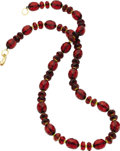Estate Jewelry:Necklaces, Amber Necklace. The necklace is composed of faceted red amberbeads, alternating with yellow bead spacers, forming a singl...(Total: 1 Item)