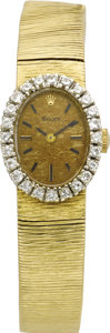 Timepieces:Wristwatch, Rolex Lady's Diamond, Gold Integral Bracelet Wristwatch, circa1970. Case: 22 x 16 mm, oval 14k yellow gold set with full-...(Total: 1 Item)