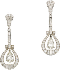 Diamond, Platinum Earrings  Each earring features a pear-shaped diamond weighing approximately 0.80 carat, enhanced by f...