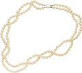 Estate Jewelry:Necklaces, Cultured Pearl, White Gold Necklace. The necklace is composed ofcultured pearls measuring 7.00 - 6.50 mm, forming two kno...(Total: 1 Item)