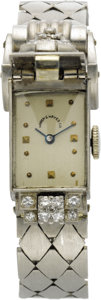 Timepieces:Wristwatch, Swiss Lady's Diamond, Platinum, White Gold Covered Dial Bracelet Watch, circa 1940. Case: 35 x 14 mm, square platinum case... (Total: 1 Item)