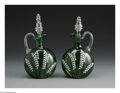 Art Glass:Other , A PAIR OF ENGLISH ENAMELED AND GILDED GLASS CLARET JUGS. Makerunknown, c.1910. Each of the green, flattened globular bodi...(Total: 2 Items)
