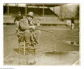 """Baseball Collectibles:Photos, 1925 Casey Stengel Wire Photograph from the Casey Stengel Collection. Great image of a young Casey """"fishing"""" in a puddle wi..."""