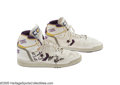 Basketball Collectibles:Uniforms, 1990's Magic Johnson Game Worn & Signed Sneakers. Supple whiteleather hi-tops with purple and gold trim and purple soles s...