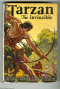 "Books:First Editions, Edgar Rice Burroughs - ""Tarzan the Invincible"" (Burroughs, 1931).This copy has the original blue cloth binding, with its fr..."