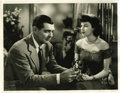 "Movie/TV Memorabilia:Photos, Ava Gardner and Clark Gable ""The Hucksters"" Photo. A handsome, vintage b&w 11"" x 14"" promo still from the 1947 dramedy, feat..."