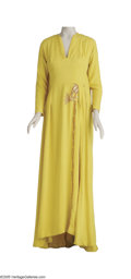 "Movie/TV Memorabilia:Costumes, ""Cleopatra"" Costume Gown. Mustard-yellow full-length gown withEgyptian-themed embroidery worn by Elizabeth Taylor in the ep... (1)"