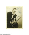 "Music Memorabilia:Autographs and Signed Items, Glenn Miller Signed Photograph. Here is a vintage sepiamatte-finish 5"" x 7"" photo of bandleader Glenn Miller holding histr..."
