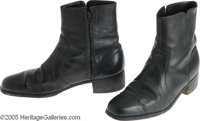"Johnny Cash Pair of Zip-Up Black Boots. ""The Man in Black"" was one of the best-loved and most-admired pop cult..."