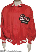 "Music Memorabilia:Memorabilia, ""Elvis in Concert"" Jacket. Here is a red 100-percent nylon ""Elvis in Concert"" jacket with white-striped collar and cuffs, si..."