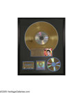 "Music Memorabilia:Awards, ""Elvis' Golden Records"" Gold Record Award. Presented to ElvisPresley Enterprises to commemorate the sale of more than 500,0...(1 )"