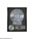 """Music Memorabilia:Awards, """"Elvis in Concert"""" Platinum Award. Presented to RCA to commemoratethe sale of more than one million albums, cassettes, and ... (1 )"""