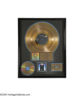 "Music Memorabilia:Awards, ""Moody Blue"" Gold Album Award. Presented to RCA to commemorate thesale of more than 500,000 copies of the 1977 album. In ex..."