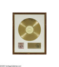 "Music Memorabilia:Awards, Rolling Stones ""It's Only Rock 'N Roll"" Gold Sales Award. Theplaque on this white matte-style award reads: ""Presented to An..."
