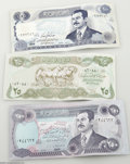 Music Memorabilia:Ephemera, Iraqi Dinar Bills. Here is a piece of history in the making: three obsolete Iraqi Dinar bills, issued by the Central Bank of... (3 Items)