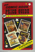 Books, Overstreet Price Guide #2 Softcover (Gemstone, 1972) Condition:VF/NM. Early comic book price guide with great cover, gloss,... (1)