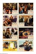"Movie Posters:Adventure, The Guns of Navarone (Columbia, R-1966). Lobby Card Set of 8 (11"" X14""). A pair of giant radar-controlled cannons sit on Na... (8Items)"