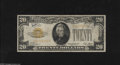 Small Size:Gold Certificates, Fr. 2402 $20 1928 Gold Certificate. Fine. This note is still colorful, but is marred by some writing on the front....