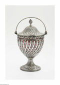 Other:American, An American Coin Silver Sugar Basket. Maker unknown, c.1850. In thestyle of a George III sugar basket, the pierced and fo...