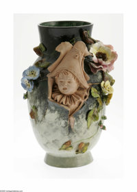 A French Terra Cotta Vase Haviland & Co., c.1900  The ovoid vase with everted rim, applied blue and pink flowers wit...
