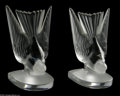 Glass, Two French Glass Bookends. Lalique, Twentieth Century. The matching footed bookends of landing birds, both frosted and cle... (2 Items)