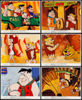 "Movie Posters:Animation, The Man Called Flintstone (Columbia, 1966). Color Photo Set of 12,Color Photo (8"" X 10"") and Uncut Pressbook (11"" x 16.75"")...(Total: 14 Items)"
