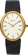 Timepieces:Wristwatch, Patek Philippe Ref. 3598 Yellow Gold Oval Wristwatch, circa 1970....