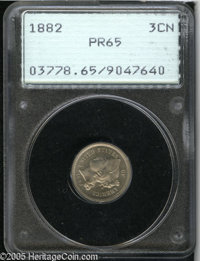 1882 3CN PR65 PCGS. Freckles of light gray and pale-blue patina dot the proof surfaces. A couple of light flecks are not...