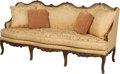 Furniture : Continental, An Italian Rococo-Style Walnut Sofa, late 18th-early 19th century.44 h x 90 w x 33 d inches (111.8 x 228.6 x 83.8 cm). ...
