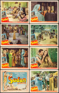 "Movie Posters:Action, Sudan & Other Lot (Universal, 1945/ R-1950). Lobby Card Set of8 (11"" X 14""), & Lobby Cards (4) (11"" X 14""). Action.. ...(Total: 12 Items)"