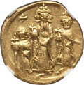 Ancients:Byzantine, Ancients: Heraclius (AD 610-641), with Heraclius Constantine andHeraclonas as Caesar. AV solidus (no weight given). NGC AU,graffito....