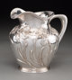 A Shreve & Co. Silver Pitcher with Iris Motif, San Francisco, California, early 20th century Marks: SHREVE &...