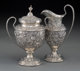 An S. Kirk & Son Co. Silver Repoussé Creamer and Sugar Urn, Baltimore, Maryland, early 20th century Marks...