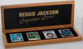 Autographs:Others, Reggie Jackson Signature Series Topps Porcelain Signed Card Set (4)With Wooden Box. . ...