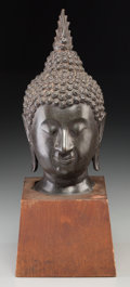 Asian:Chinese, A Thai Patinated Bronze Head of Buddha, 20th century. 18 incheshigh (45.7 cm) (overall). ...