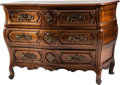 Furniture , A Régence-Style Walnut Commode. 35 h x 48 w x 25 d inches (88.9 x 121.9 x 63.5 cm). ...