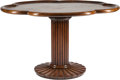 Furniture , An Art Moderne-Style Mahogany Center Table with Lotus Motif. 32inches high x 53 inches diameter (81.3 x 134.6 cm). ...