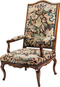 Furniture : French, A Régence-Style Needlepoint Upholstered Walnut Armchair. 45 h x 27 w x 30 d inches (114.3 x 68.6 x 76.2 cm). ...