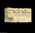 Colonial Notes:North Carolina, North Carolina March 9, 1754 20s Very Fine. The edges are a bittattered and some minor splits have been repaired, but the n...