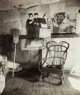 Walker Evans (American, 1903-1975) Interior of Coal Miner's Home with Rocking Chair and Advertisements on Wall, West Vir...