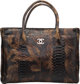 "Chanel Brown Python Cerf Tote Bag Condition: 3 13.5"" Width x 8"" Length x 5"" Depth This bag is done in bro..."