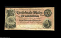 Confederate Notes:1864 Issues, T64 $500 1864. This serial number 4589 note is of the scarcer dark red tint variety. The left-hand edge is inside the frame ...